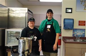 Food service workers pose in the AlleC Bistro.